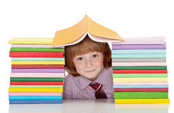 Small school boy with lots of books Royalty Free Stock Images