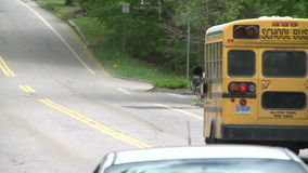 Small school bus traveling on road (1 of 5)