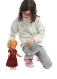 Girl with doll Stock Image