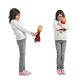 Girl with doll Stock Photography