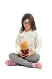 Girl with doll Royalty Free Stock Photo
