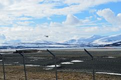 Small school plane attempts to land on Langnes airport. In northern norway stock images