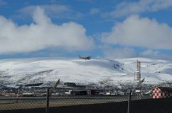 Small school plane attempts to land. On Langnes airport stock image