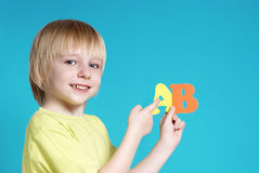 The small schoolboy with letters Royalty Free Stock Photography
