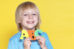 The small schoolboy with letters Stock Photography