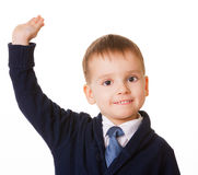 Small schoolboy raises his hand for answer Stock Image