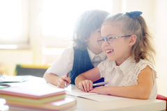 Small schoolcilds do a homework. Stock Photos