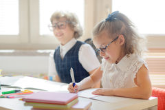 Small schoolkids in the lesson. Royalty Free Stock Photo