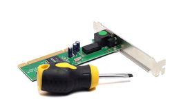 Small screw driver and network adapter Stock Images