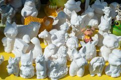 Small sculptures of white clay. The art of creating bulk of work royalty free stock image