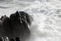 Small sea cape under heavy storm Stock Photos