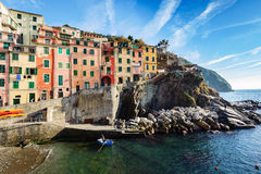 Small sea fishing port at bay of Riomaggiore town. Stock Photo