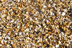 Small sea pebble sand background royalty free stock images
