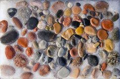Small sea stones and ice background Royalty Free Stock Photos