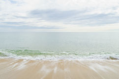 Small sea wave on a sandy beach Stock Images