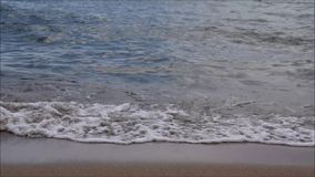 Small sea waves. Small waves on the sandy seashore. Greece, Rhodes, Pefkos stock video footage
