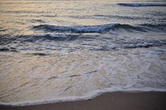 Small Sea waves before the sunrise Royalty Free Stock Images