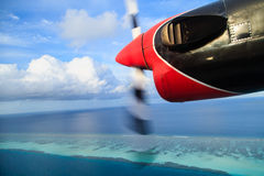 Small seaplane flying to the beach resort Royalty Free Stock Image
