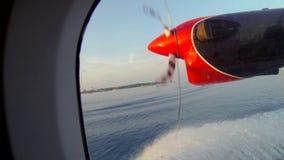 Small seaplane landing in the Maldives. Small seaplane landing in water in the Maldives stock video