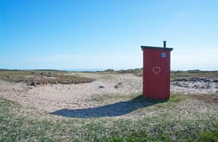 Small seaside toilet house Royalty Free Stock Image