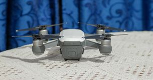 Small selphie camera drone on table royalty free stock photos