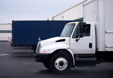Small semi truck with box on warehouse parking lot Royalty Free Stock Photos