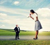 Small senior man and big young woman Royalty Free Stock Image