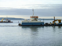 A small service ship in a cargo industrial port. A ship in the sea Stock Photography