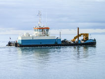 A small service ship in a cargo industrial port. A ship in the sea Royalty Free Stock Photography