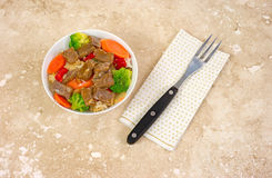 Small serving of beef teriyaki with fork on napkin Royalty Free Stock Photography