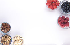 Small serving bowls filled with fruit and nuts Royalty Free Stock Photo