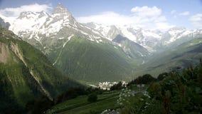 Small settlement. Beautiful mountains in the summer on Dombai. Settlement Dombai Stock Photography