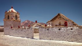 Small seventeenth-century church in the village of Parinacota, at 4,400 meters above sea level, in the Lauca National Park,. Small seventeenth-century church in royalty free stock photos