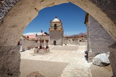 Small seventeenth-century church in the village of Parinacota, at 4,400 meters above sea level, in the Lauca National Park,. Small seventeenth-century church in royalty free stock photo