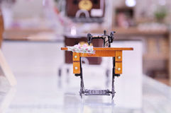 Small sewing machine. Refined beautiful sewing machine .color Stock Image