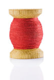 Small sewing spool with red thread Royalty Free Stock Photo