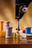 Small sewing wooden bobbin with other items Royalty Free Stock Photo