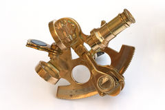 Small sextant. A miniature brass sextant, for measuring the height of the sun or stars to determine latitude