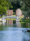 The small shabby bridge in park over a pond. Gatchina. Petersburg. Russia. Royalty Free Stock Photo