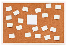 Small sheets of paper on bulletin cork board Royalty Free Stock Photography