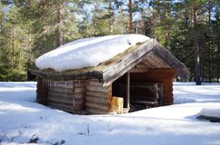 A small shelter in a forest. A small wooden shelter for hikers in a forest in Dalarna Royalty Free Stock Photography