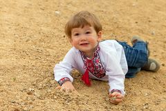 Small shild fall down and smile Royalty Free Stock Images