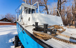Small ship on the bank of river Stock Photo