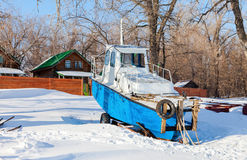 Small ship on the bank of river Stock Image