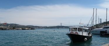 Small ship at the European Side of Bosphorus, in Istanbul, Turkey Stock Images
