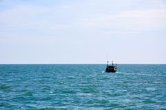 Small ship and ocean Stock Image