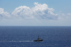 Small ship sailing on the ocean Royalty Free Stock Images