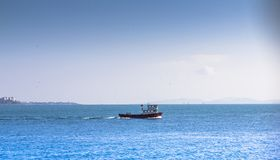 Small ship in the sea. Blue sky and blue sea stock photography
