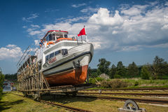 Small ship swimming on land Stock Photography