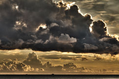 Small ship with threatening clouds, Vietnam. Small ship with threatening clouds over South China Sea at Phu Quoc, Vietnam Stock Photography